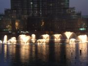 Dubai Fountain sputtering under testing March 2009 with Burj Dubai behind