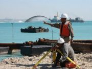 workers on the Jumeirah Palm island in Dubai